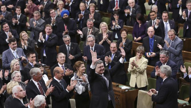 Ukraine's President Poroshenko acknowledges a standing ovation after addressing a joint session of Parliament in Ottawa