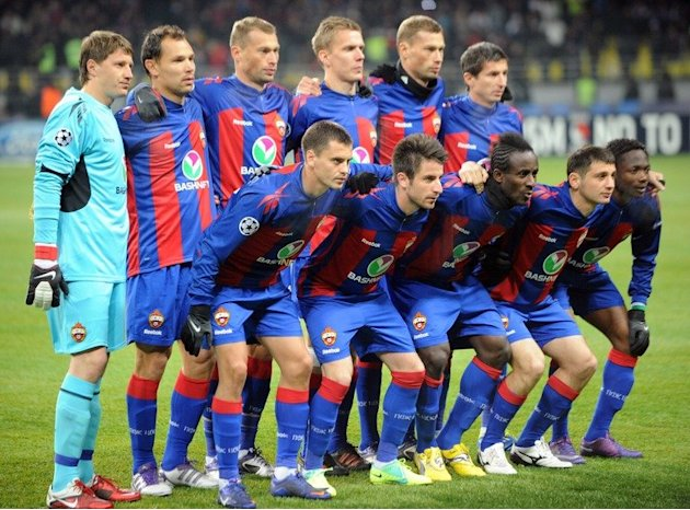 CSKA Moscow players pose before their first leg Champions League match against Real Madrid in Moscow on February 21, 2012