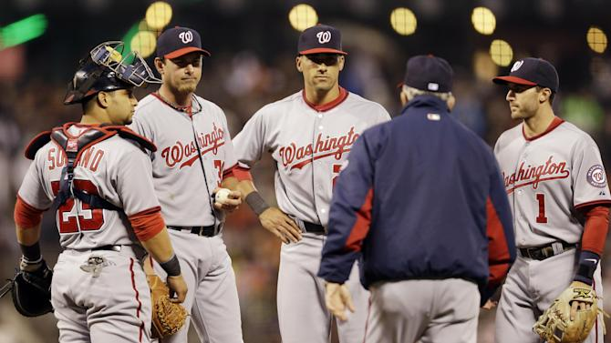 Washington Nationals starter Zach Duke, second from left, is pulled from the game by manager Davey Johnson, second from right, during the fourth inning of a baseball game on Monday, May 20, 2013 in San Francisco. (AP Photo/Marcio Jose Sanchez)