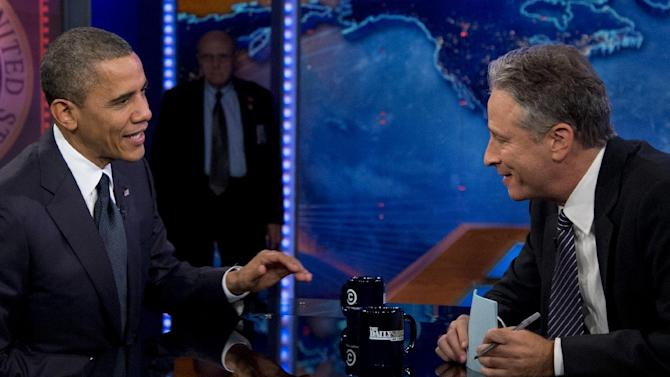 """President Barack Obama talks with Jon Stewart during a taping of his appearance on """"The Daily Show with John Stewart"""", Thursday, Oct. 18, 2012, in New York. (AP Photo/Carolyn Kaster)"""