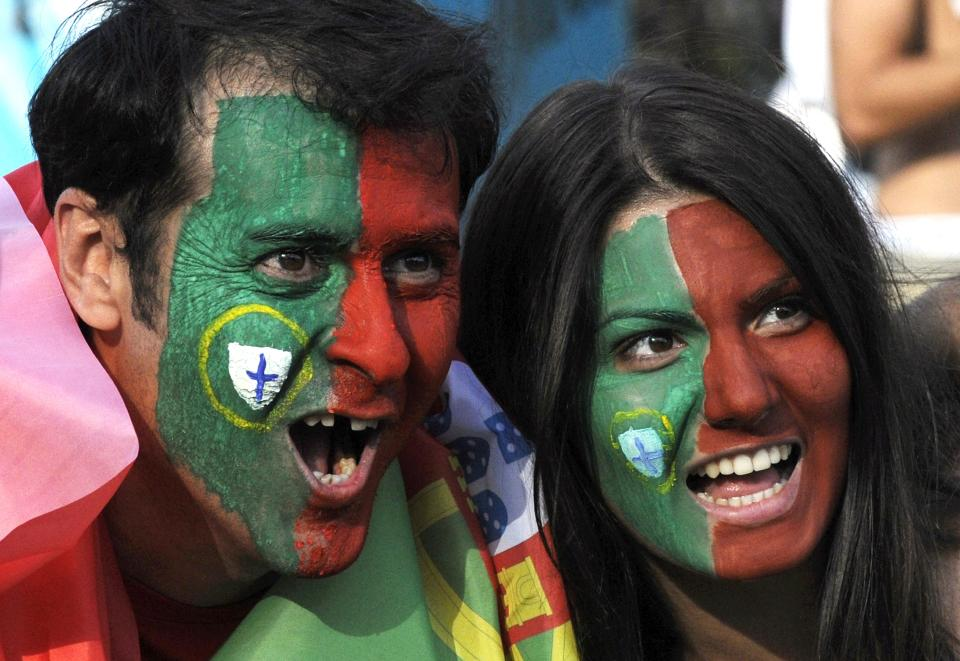Portugal fans cheer before the semifinal match between Spain and Portugal at the  Euro 2012 soccer championship in Donetsk, Ukraine, Wednesday, June 27, 2012. (AP Photo/Sergei Chuzavkov)