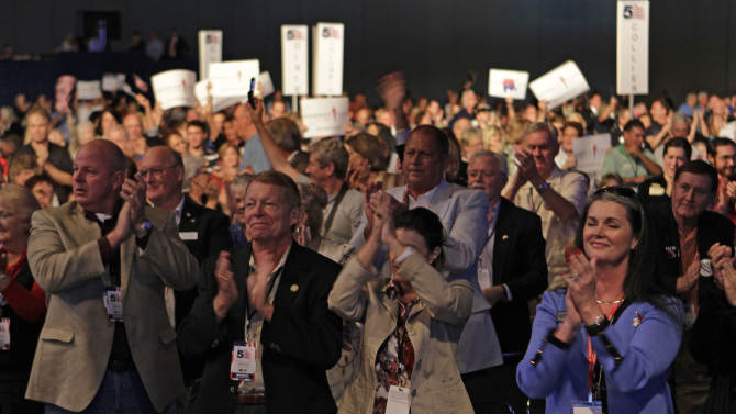 Delegates cheer during a speech by Republican presidential candidate, businessman Herman Cain, before a straw poll during a Florida Republican Party Presidency 5 Convention Saturday, Sept. 24, 2011, in Orlando, Fla. (AP Photo/John Raoux)