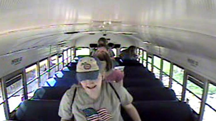 This image from video provided by The Iowa Department of Public Safety shows Kathlynn Shepard, 15, as she exits a school bus shortly before her abduction on Monday, May 20, 2013. Investigators say they recovered Shepard's backpack along with one belonging to a 12-year-old who escaped from the kidnapper. Police continued their search Wednesday, May 20, for Kathlynn around Dayton, about 60 miles north of Des Moines. (AP Photo/Iowa Department of Public Safety)