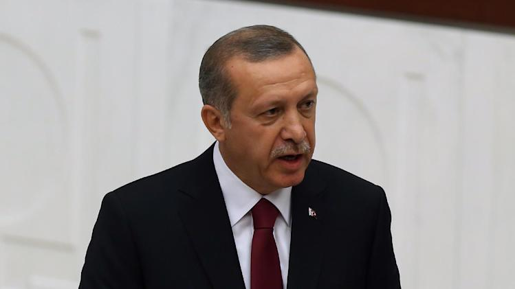 Turkey's new President Recep Tayyip Erdogan takes oath of office at the parliament in Ankara, Turkey, Thursday, Aug. 28, 2014. Erdogan was sworn in as Turkey's first popularly elected president, a position that will keep him in the nation's driving seat for at least another five years. Erdogan was scheduled to appoint Foreign Minister Ahmet Davutoglu, his designated successor as prime minster and loyal ally, to form a new government, following ceremonies at the presidential palace. Just before Erdogan took the oath of office in parliament, legislators from Turkey's main opposition party left the hall in mass in protest of the man they accuse of not respecting Turkey's constitution.(AP Photo/Burhan Ozbilici)