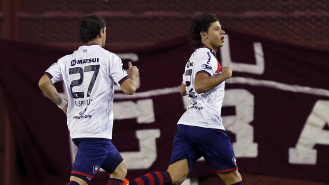 Oscar Romero of Paraguay's Cerro Porteno celebrates his goal with teammate Mauricio Sperdutti during their Copa Sudamericana soccer match against Argentina's Lanus in Buenos Aires