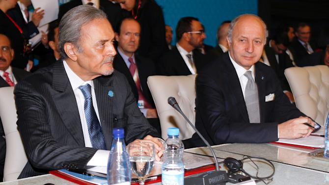 "Saudi Arabia's Foreign Minister, Saud Al Faisal, left, French Foreign Minister Laurent Fabius, right, wait for the start of a meeting of the Friends of the Syrian People in Marrakech, Morocco, Wednesday Dec. 12, 2012. The Syrian opposition called for ""real support"" and not just recognition on Wednesday, hours after the U.S. declared its new coalition was the ""legitimate representative"" of its country's people. Bnner behind reads: 4th meeting of the group of ""Friends of the Syrian People"". (AP Photo/Abdeljalil Bounhar)"