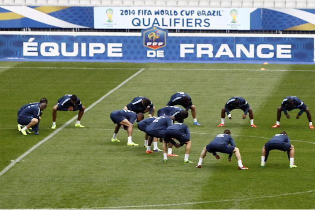 France's soccer team warms up during a training session at the Stade de France stadium in Saint Denis, north of Paris, Monday, Oct. 14, 2013, ahead of their 2014 World Cup Group I qualifying soccer ma