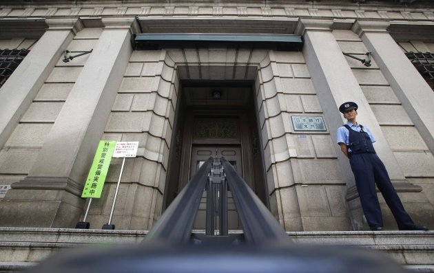 A security personnel stands guard at the Bank of Japan building in Tokyo