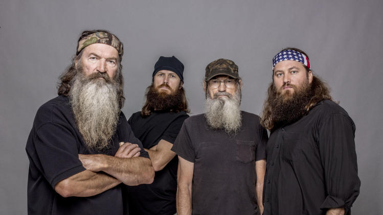 "This 2012 photo released by A&E shows, from left, Phil Robertson, Jase Robertson, Si Robertson and Willie Robertson from the A&E series, ""Duck Dynasty,"" airing Wednesdays at 10 p.m. EST. (AP Photo/A&E, Zach Dilgard)"