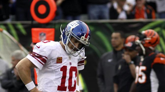 New York Giants quarterback Eli Manning walks off the field in the second half of an NFL football game against the Cincinnati Bengals, Sunday, Nov. 11, 2012, in Cincinnati. (AP Photo/Tom Uhlman)