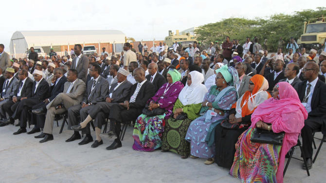 New Somali members of parliament   during the swearing in  ceremony of 211 MP's at Aden Ade international airport in Mogadishu, Somalia, Monday, Aug 20, 2012.   Somalia's newly-selected members of parliament were on Monday sworn in as the Horn of Africa country moves from the long-drawn transitional period to a permanent form of government. (AP Photo/Farah Abdi Warsamehmeh)