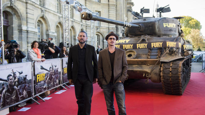 "US actor Brad Pitt (R) and US screenwriter and director David Ayer (L) pose on the red carpet during a photocall for the film ""Fury"", on October 18, 2014 in Paris"