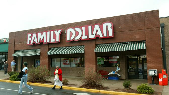FILE - In this Tuesday, Nov. 29, 2005, file photo, customers walk past a Family Dollar store at Hickory Grove Market in Charlotte, N.C. Dollar Tree is buying rival discount store Family Dollar in a cash-and-stock deal valued at about $8.5 billion, the companies announced Monday, July 28, 2014. (AP Photo/Ross Taylor, File)