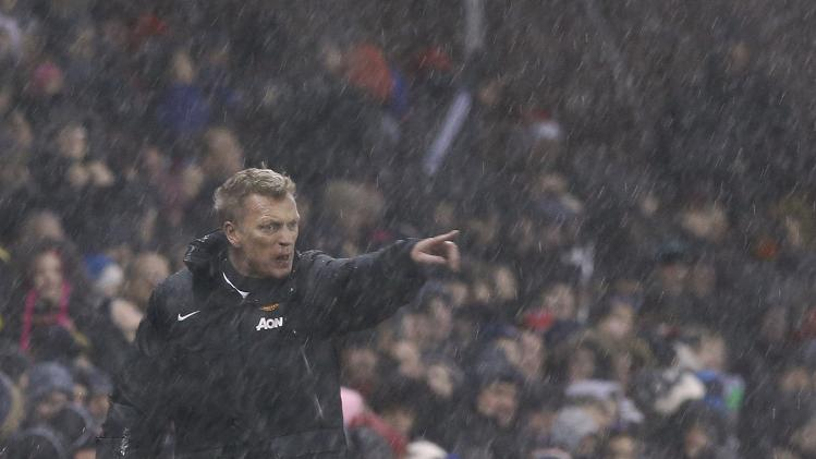 Manchester United's manager Moyes points during their English League Cup quarter-final soccer match against Stoke City at the Britannia stadium in Stoke-on-Trent