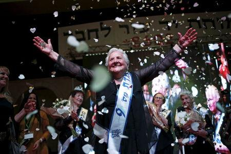 Broad smiles and enduring spirit at Holocaust survivors' beauty contest