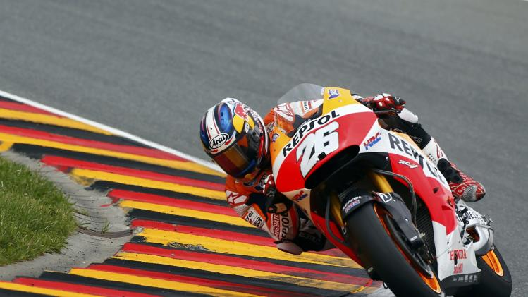 Honda MotoGP rider Pedrosa of Spain competes during the German Grand Prix at the Sachsenring circuit in the eastern German town of Hohenstein-Ernstthal