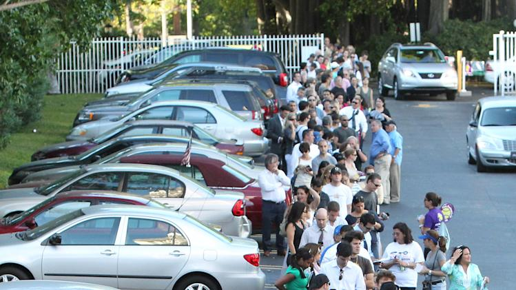 People wait in line to vote in Miami on Election Day Tuesday, Nov. 6, 2012. (AP Photo/El Nuevo Herald, David Santiago)  MAGS OUT