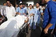 <p>Medics wheel a wounded Palestinian into the al-Shafa hospital in Gaza City on October 22. Israeli launched two air strikes on Monday around the northern Gaza town of Beit Hanun where militants were firing mortar rounds at an Israeli tank and military vehicles which had crossed into Gaza territory, witnesses and security sources said.</p>