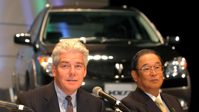 "FILE - In this Aug. 20, 2002 file photo, General Motors Group Vice President Mark T. Hogan, left, speaks as Toyota Motor Corp. President Fujio Cho looks on during a press unveiling of compact sport utility vehicle ""Voltz,"" jointly designed by Toyota and General Motors Corp. in Tokyo. Toyota has tapped a former executive at U.S. rival General Motors to be on its board, the first time in the Japanese automaker's 76-year history it is appointing board members from outside the company. The appointment of Hogan, effective April 1, which was announced at a press conference in Tokyo Wed., March 6, 2013, underlines efforts at Toyota Motor Corp. to grow more international, nimble, transparent and responsive to regional markets as it recovers from difficult years, including the massive recall fiasco in the U.S., to regain its position as the world's top automaker. (AP Photo/Koji Sasahara, File)"