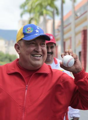 In this photo released by Miraflores Press Office, Venezuela's President Hugo Chavez holds a baseball after delivering a message on state TV at Miraflores presidential palace in Caracas, Venezuela, Thursday Sept. 29, 2011. Chavez denied rumors of a setback in his health, saying he is at work and expects to finish with cancer treatments soon.  Chavez underwent surgery in Cuba in June to remove a tumor from his pelvic region.  (AP Photo/Miraflores Press Office)