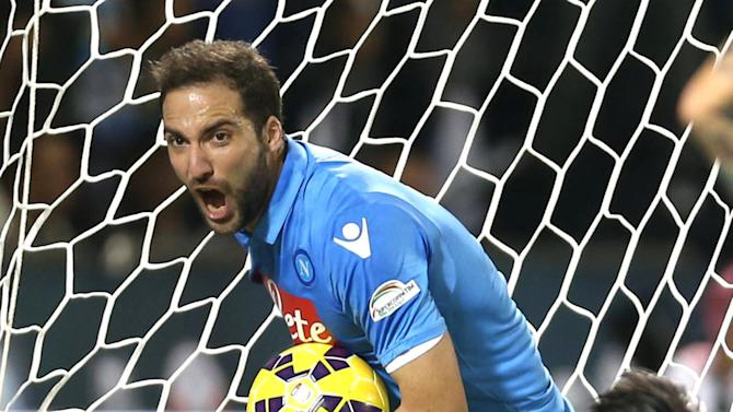 Napoli's Gonzalo Higuain celebrates after scoring a goal during their Italian Super Cup soccer match against Juventus at Al-Sadd Stadium, in Doha