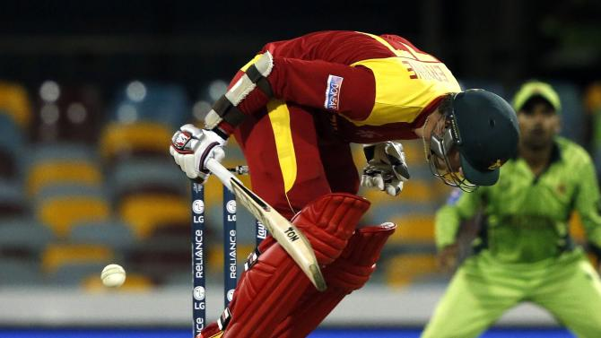 Zimbabwe's Craig Ervine is struck by a short delivery from Pakistan's Mohammad Irfan during their Cricket World Cup match at the Gabba in Brisbane