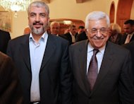 Hamas exiled chief Khaled Meshaal (L) and Palestinian president Mahmud Abbas meet in Cairo on November 24, 2011, in this photo released by the Palestinian Hamas movement. Abbas and Meshaal have agreed to expedite a stalled reconciliation deal between the rival factions, a Hamas official said Thursday