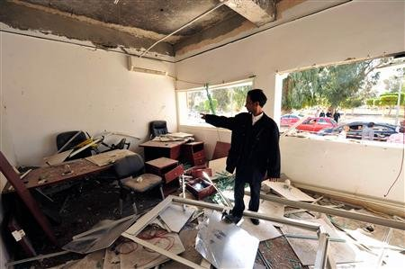 A policeman stands inside an office of a police station after a bomb explosion in Benghazi, April 27, 2013. REUTERS/Esam Al-Fetori