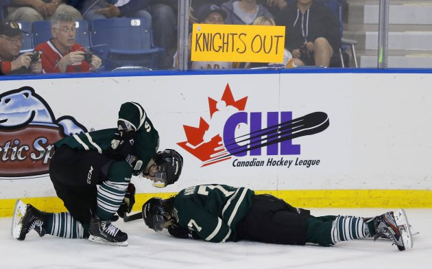 London Knights' Anderson lays on this ice after getting hit by a stick while Harrington checks on him during their game against the Saskatoon Blades' in the Memorial Cup Canadian Junior Hockey Champio