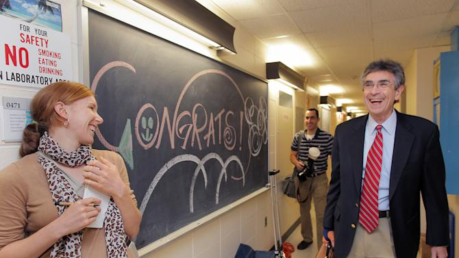 Dr. Robert Lefkowitz, right, of Duke University, arrives at his office at Duke to congratulations on Wednesday, Oct. 10, 2012, the day Lefkowitz heard he had won the 2012 Nobel Prize in chemistry. Lefkowitz and Brian Kobilka of Stanford University School of Medicine won the Nobel Prize in chemistry Wednesday for studies of protein receptors that let body cells sense and respond to outside signals like danger or the flavor of food. Such studies are key for developing better drugs. (AP Photo//Ted Richardson)