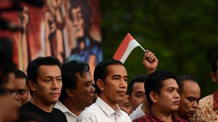 Indonesian president-elect Joko Widodo (C) prepares to address supporters at a rally in Jakarta on July 23, 2014