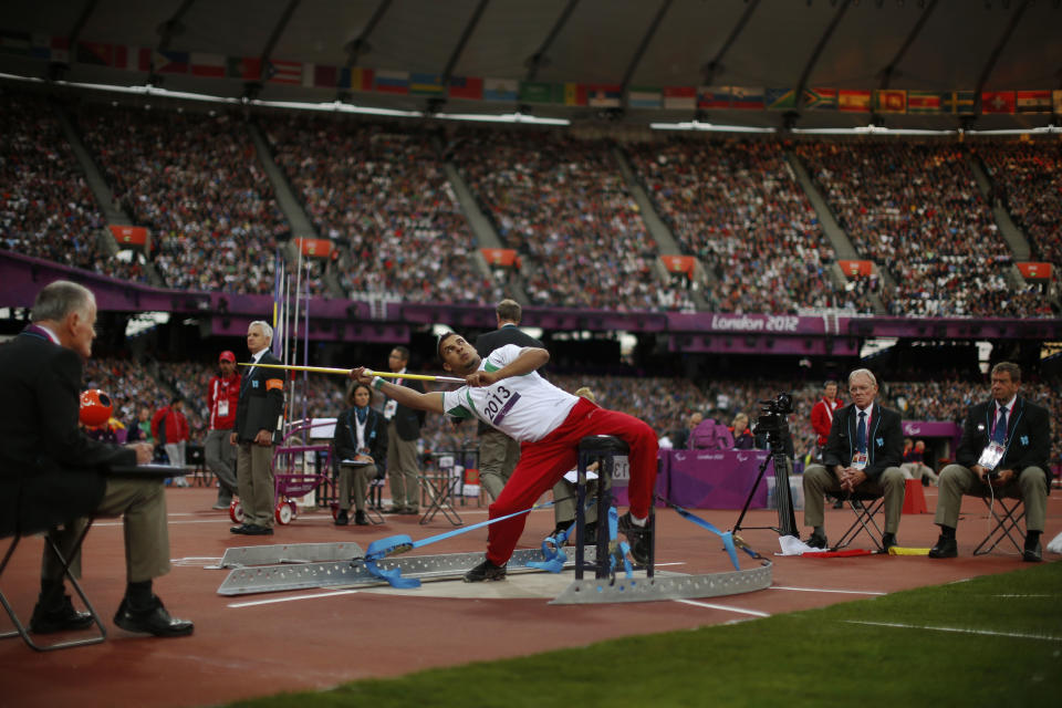 Algeria's Kamel Kardjena leans back to make a throw in the men's javelin F33/34 category event during the athletics competition at the 2012 Paralympics, Saturday, Sept. 1, 2012, in London.  (AP Photo/Matt Dunham)