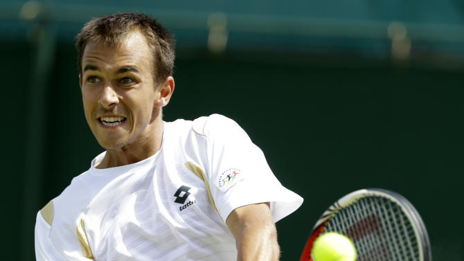 Lukas Rosol of the Czech Republic returns a shot to Philipp Kohlschreiber of Germany during a third round men's singles match at the All England Lawn Tennis Championships at Wimbledon, England, Saturday, June 30, 2012. (AP Photo/Kirsty Wigglesworth)