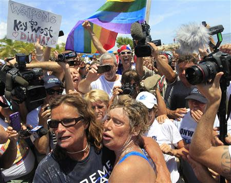 U.S. long-distance swimmer Diana Nyad is welcomed ashore after completing her swim from Cuba as she arrives in Key West