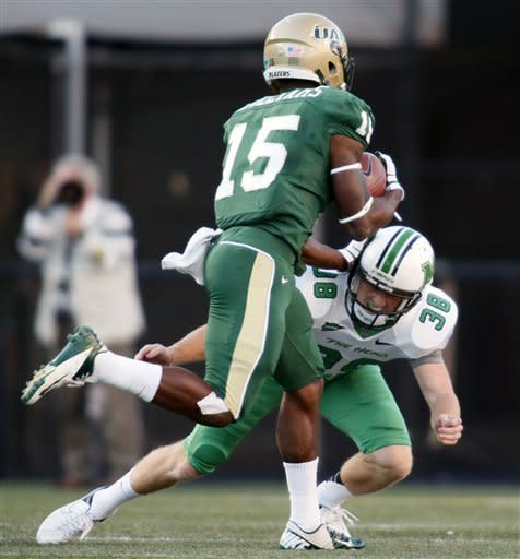Reaves, UAB hold off Marshall rally for 38-31 win