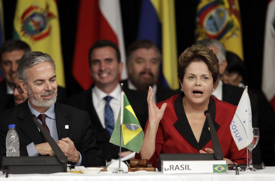 Brazil's President Dilma Rousseff, right, addresses the Mercosur summit meeting as her Foreign Minister Antonio Patriota sits by in Mendoza, Argentina, Friday, June 29, 2012.  (AP Photo/Natacha Pisarenko)