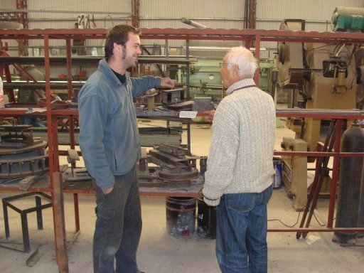 Image provided by Teruo Higo (R) shows the former Sony engineer giving instructions to a local engineer at a factory in Marcos Juarez, Argentina, in 2010. A scheme offering Japan's seniors the chance to work abroad is increasingly being seen as a good way to keep active during retirement