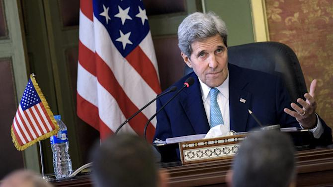 U.S. Secretary of State John Kerry speaks during a news conference after a meeting at the Ministry of Foreign Affairs in Cairo