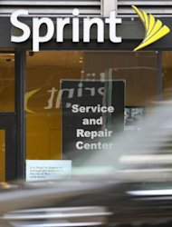 "<p>A car drives past a shop offering Sprint Nextel mobile phone service in New York. Sprint chief executive Dan Hesse says the tie-up with Softbank is a ""transformative transaction"", giving Sprint liquidity to remain competitive in a US field dominated by AT&T and Verizon Wireless.</p>"