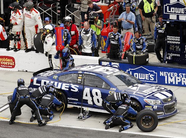Jimmie Johnson pits for tires and fuel during the NASCAR Daytona 500 Sprint Cup Series auto race at Daytona International Speedway, Sunday, Feb. 24, 2013, in Daytona Beach, Fla. (AP Photo/David Graham