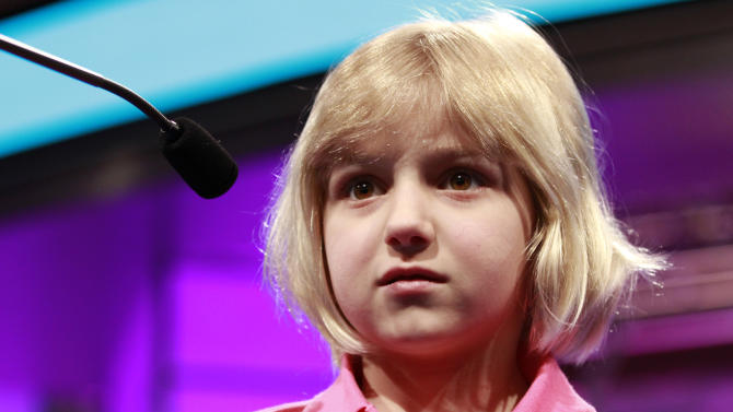 Lori Anne Madison, 6, of Woodbridge, Va., the youngest speller ever to compete in the National Spelling Bee, reacts after misspelling her word, ingluvies, in the third round of the bee in Oxon Hill, Md., on Wednesday, May 30, 2012. She will not be moving on to the semifinals. (AP Photo/Jacquelyn Martin)