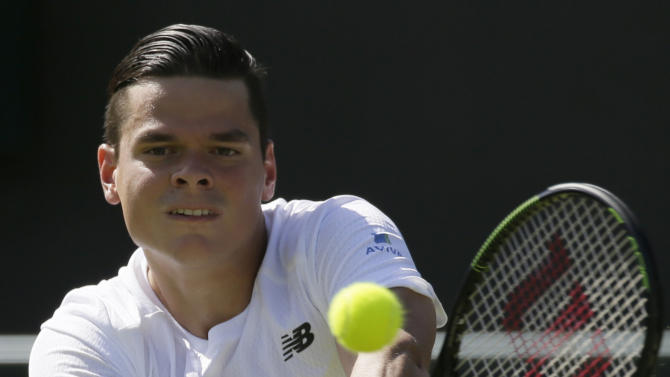 Milos Raonic of Canada plays a return during the men's singles first round match against Daniel Gimeno-Traver of Spain at the All England Lawn Tennis Championships in Wimbledon, London, Monday June 29, 2015. (AP Photo/Tim Ireland)