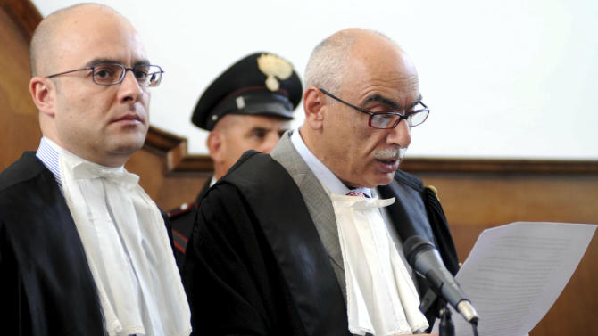 Court president Bruno Muscolo reads the verdict over the massacre in which six Italian men were gunned down in Duisburg, Germany, in Locri, southern Italy, Tuesday, July 12, 2011. News reports say the court sentenced the ringleader of the massacre Giovanni Strangio and other seven people to life terms for their role in the violent mob feud that culminated in the Duirsburg slayings. The six Italian men were gunned down Aug. 15, 2007, as they left a birthday party at an Italian restaurant in the western German city. (AP Photo/Adriana Sapone)