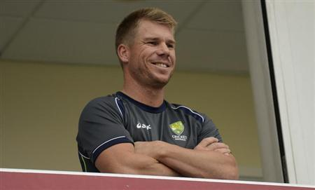 Australia's Warner looks on as the fourth day of the fifth Ashes cricket test match against England was delayed by rain at the Oval cricket ground, London