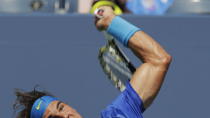 Rafael Nadal of Spain serves to David Nalbandian of Argentina during the U.S. Open tennis tournament in New York, Sunday, Sept. 4, 2011. (AP Photo/Charlie Riedel)