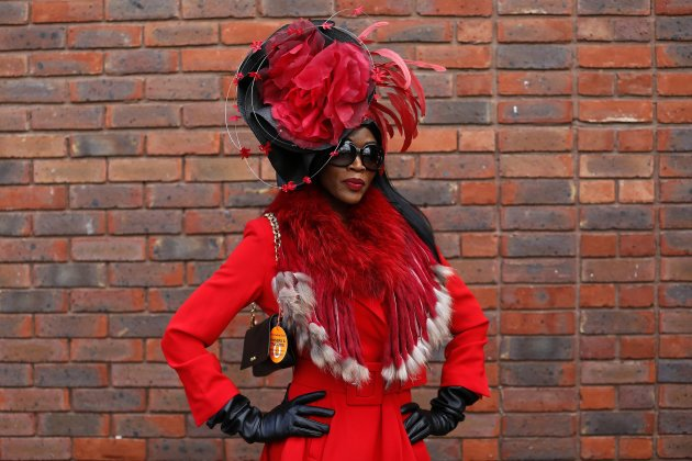 Racegoer Adams poses in her hat on Ladies Day at the Cheltenham Festival horse racing meet in Gloucestershire
