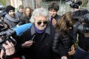 Five Star Movement leader and comedian Beppe Grillo speaks with media before casting his vote at the polling station in Genoa