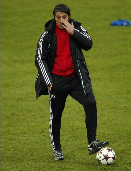 FC Basel's coach Yakin reacts during a training session in Gelsenkirchen