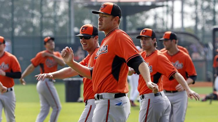 FILe - In this Feb. 24, 2014 file photo, Baltimore Orioles' Chris Tillman, center, warms up with teammates during the team's baseball spring training workout in Sarasota, Fla., Tillman finally put it all together last season, doubling his win total during a 16-7 year that probably earned him his first opening day start. (AP Photo/Gene J. Puskar, File)