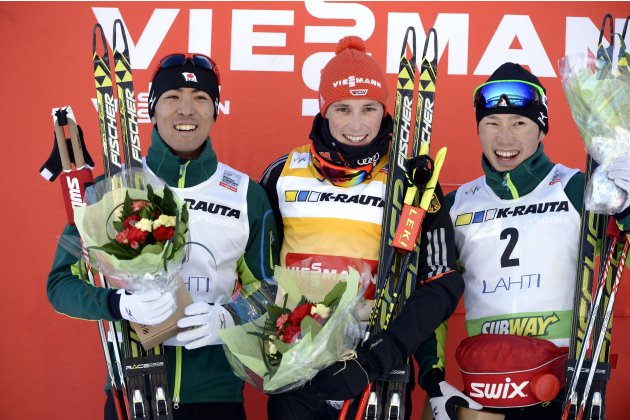 Akito Watabe of Japan, winner Eric Frenzel of Germany and Taihei Kato of Japan celebrate after the Nordic Combined individual Gundersen 10 km cross country skiing event at the FIS World Cup Lahti Ski